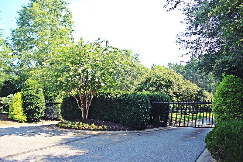 The tree-lined entry is beautiful, especially in the summer when the crepe myrtles are in bloom.
